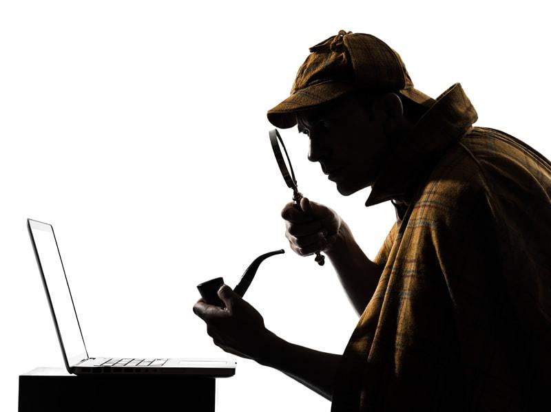 Sherlock Holmes At Laptop